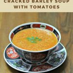 Cracked barley and tomato soup in traditional Moroccan bowl.