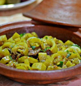 Moroccan clay tagine dish with beef and bottle gourds