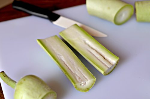 a section of bottle gourd cut in half lengthwise to reveal the interior