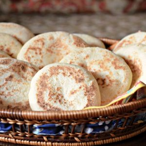 Photo of batbout, Moroccan pita bread, in a basket on a table.