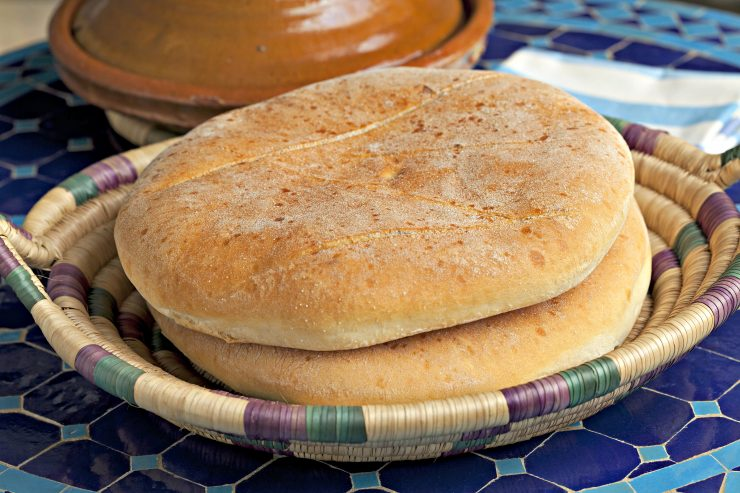 two loaves of Moroccan flatbread called khobz in a traditional basket