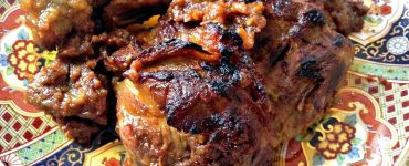 braised and roasted Moroccan lamb with onion confit on a platter