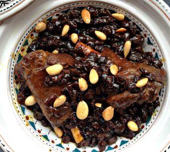 overhead photo of mrouzia, a Moroccan lamb confit with raisins, almonds and honey