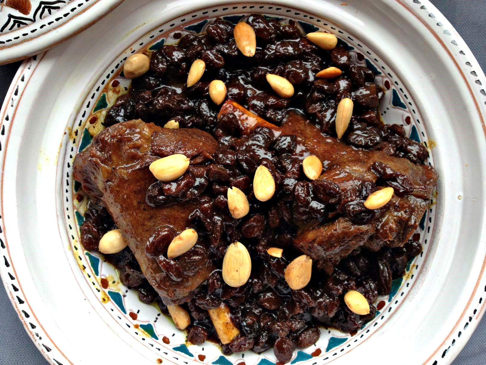 overhead photo of mrouzia, a Moroccan lamb confit with raisins, almonds and honey