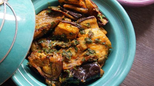 A small tagine filled with oven-roasted chunks of eggplant marinated in chermoula.