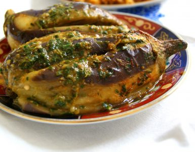A whole steamed eggplant with chermoula, a Moroccan herb and spice marinade.