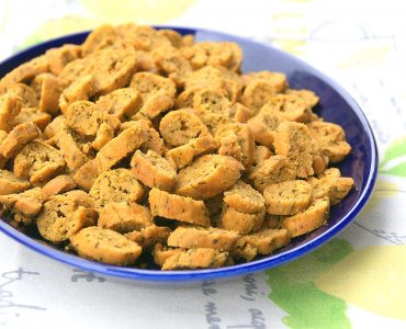 Moroccan petite fekkas with chermoula on a plate. They are bite-sized savory cookies which are baked twice like biscotti.