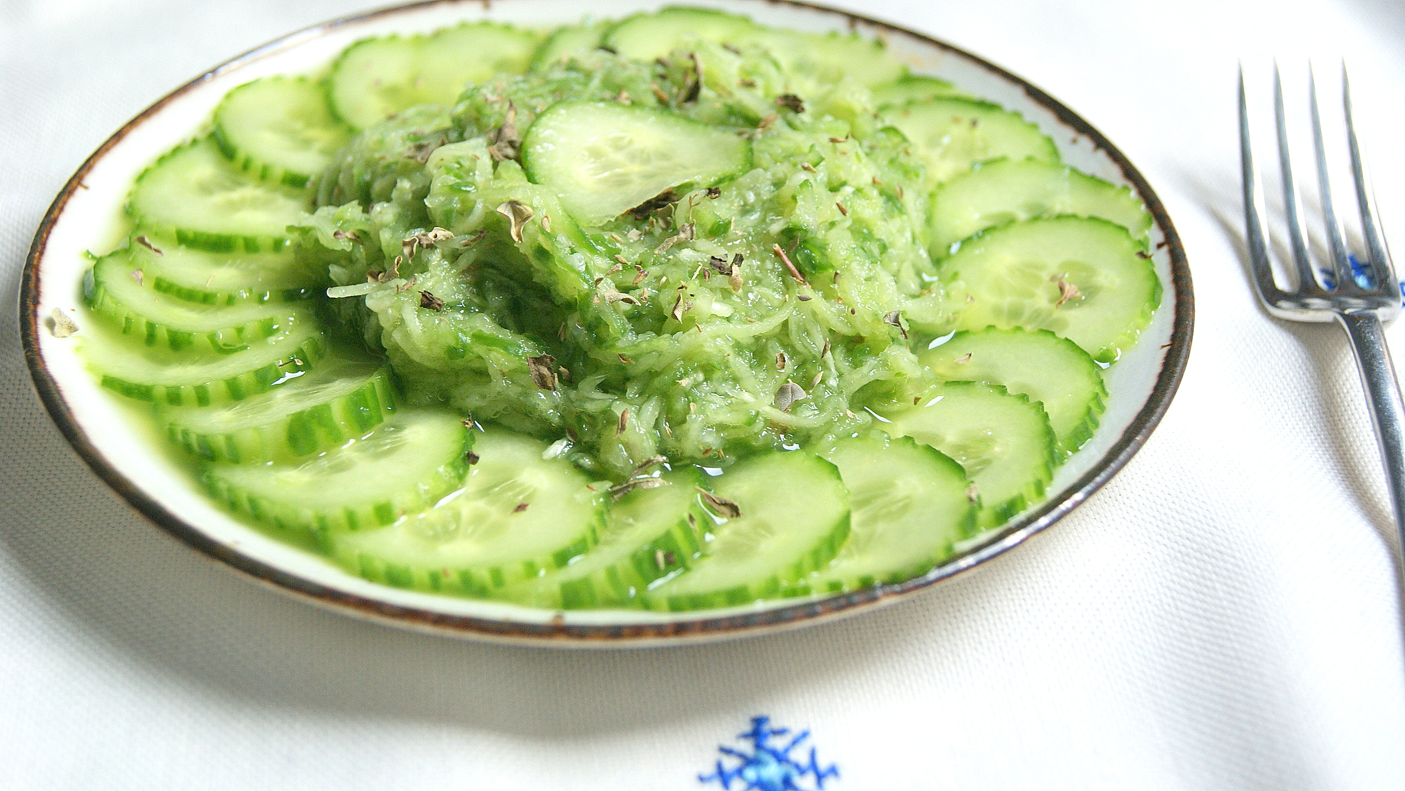 Moroccan bendy cucumber salad with oregano in grated and sliced form