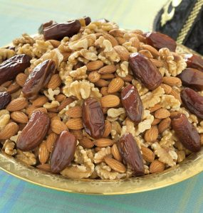 Walnuts, almonds and dates are mounded into a Moroccan serving dish.