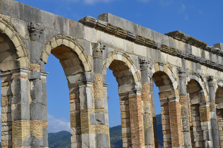 Massive stone arches from the Roman ruins of Volubilis in Morocco.