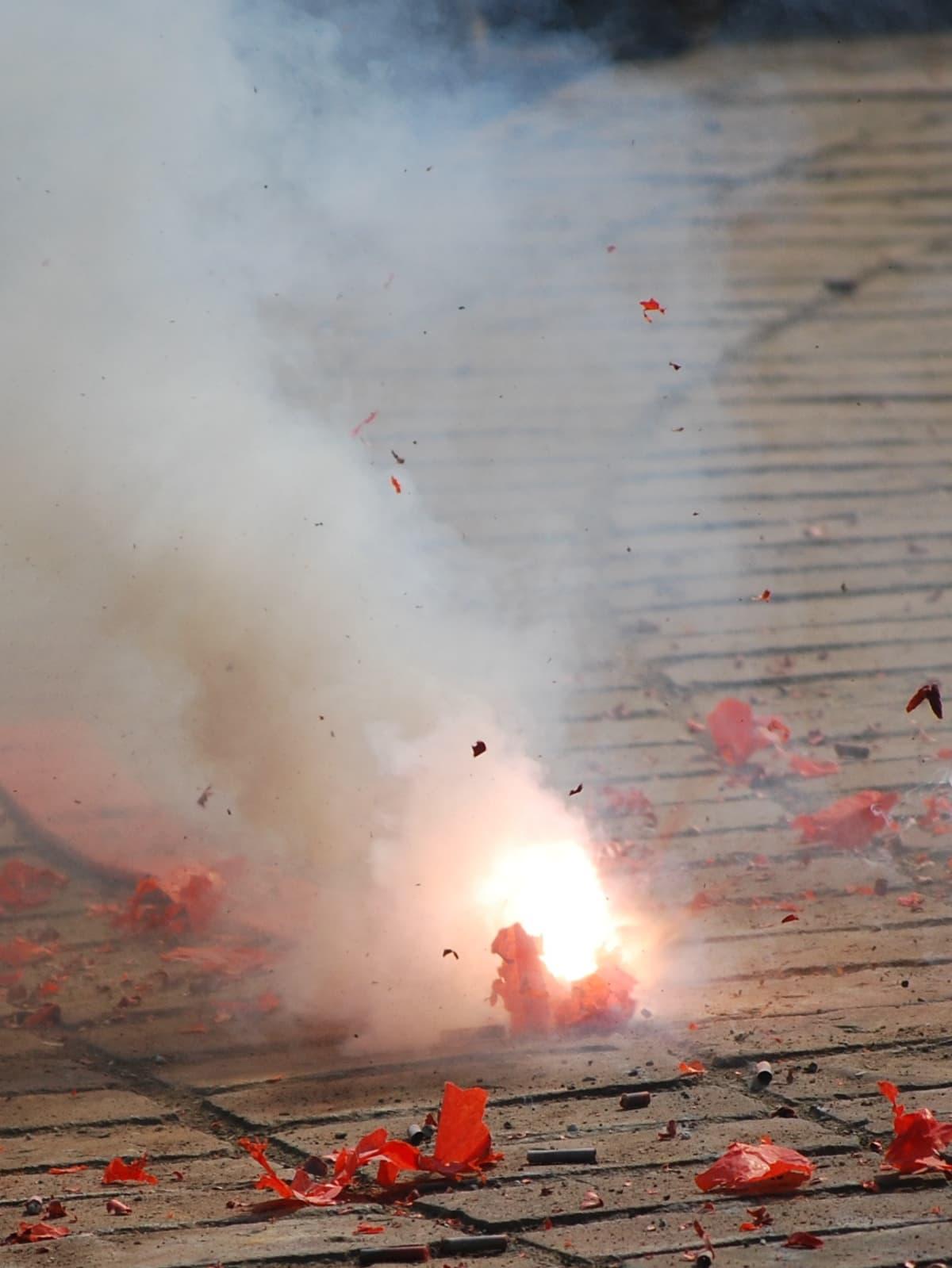 Smoking firecracker on the ground.