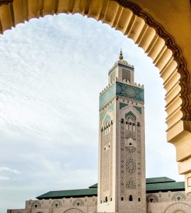 A view through an arch of the minaret of Hassan II mosque in Casablanca.