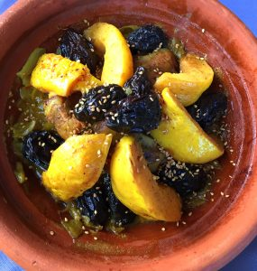 Moroccan tagine with lamb, quinces and prunes, cooked m'qualli-style and sprinkled with sesame seeds