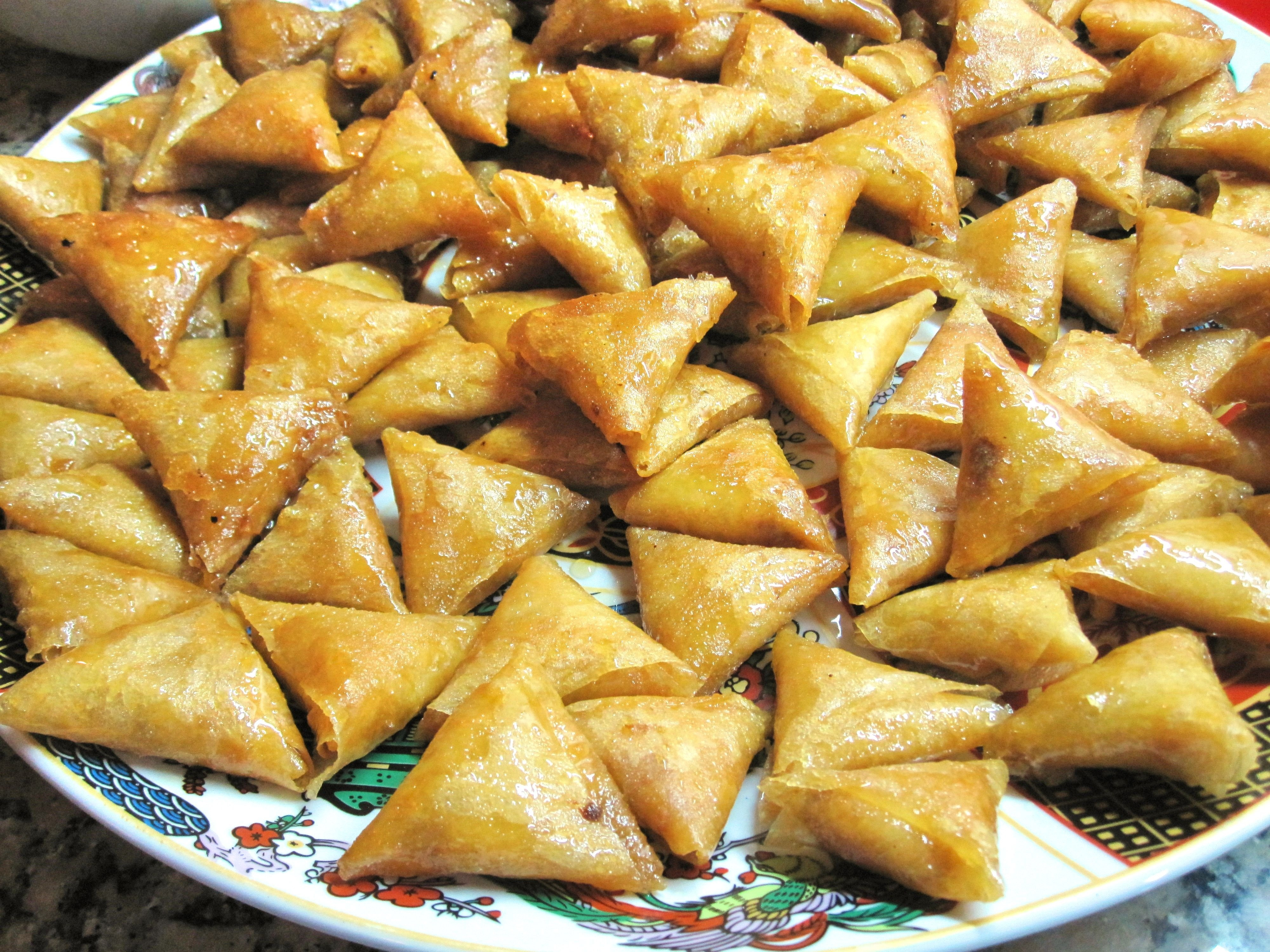 A platter of almond briouats, a Moroccan triangular shaped pastry filled with almond paste.
