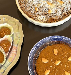 Overhead photo of three different presentations of sellou, a Moroccan paste-like sweet made from ground almonds, ground sesame and flour.