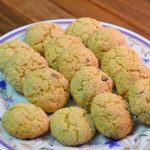 Moroccan semolina cookies called harcha dyal ferran sit on a serving plate.