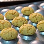 Moroccan shortbread cookies with cracked tops are sitting on top of their molds.