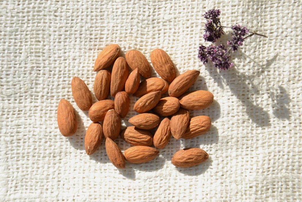 Overhead view of almonds on textured fabric.