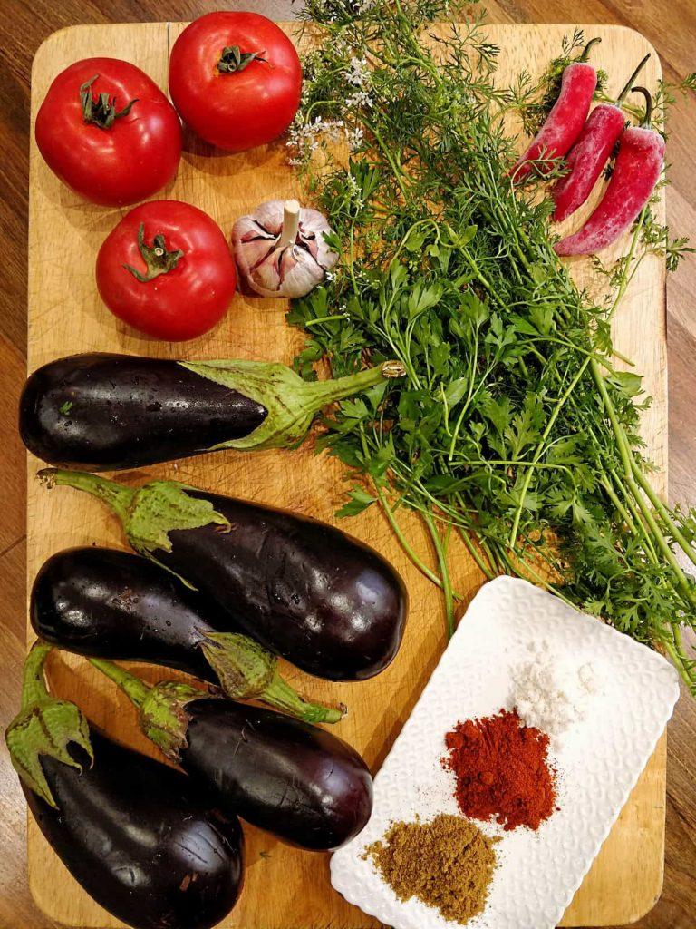 Zaalouk ingredients on a cutting board.
