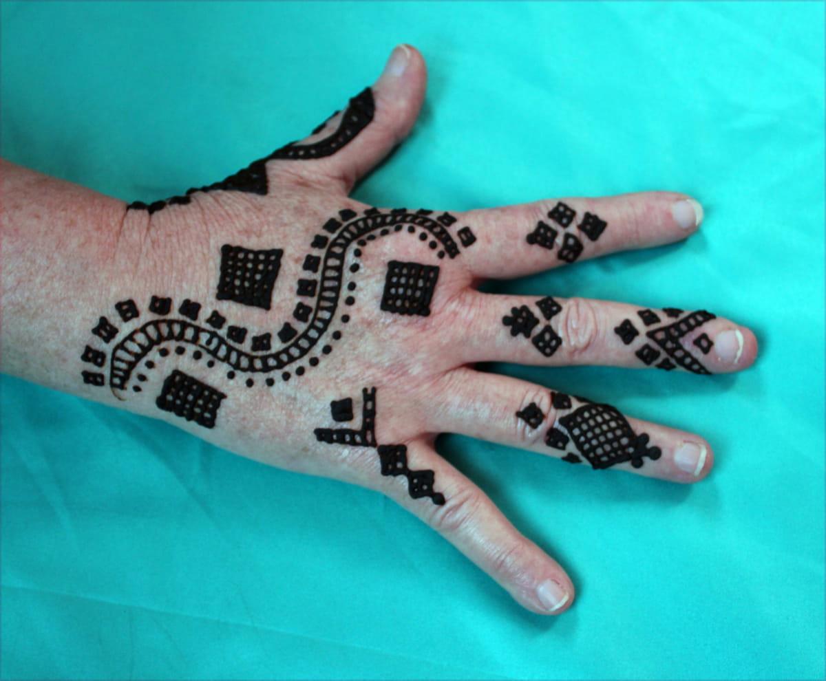 Hand with henna paste tattoo.